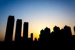 Silhouette of building in the city at twilight Stock Photos