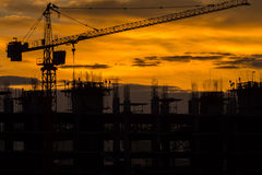 Silhouette of building and crane Royalty Free Stock Photo