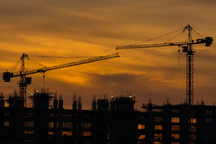 Silhouette of building and crane Stock Photo