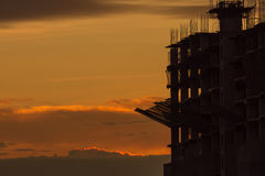 Silhouette of building and crane Royalty Free Stock Images