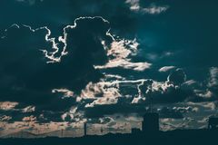 Silhouette of Building Under Cloudy Blue Sky Stock Image