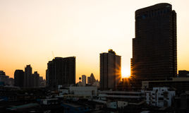 Silhouette of buildings and sunset in the evening Royalty Free Stock Image