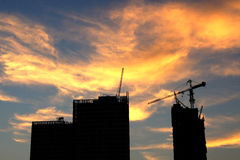 Silhouette buildings under construction Stock Image