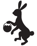 Silhouette bunny with basket Stock Photo