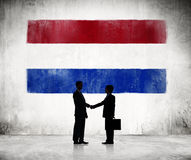 Silhouette of a Business Handshake with a Dutch Flag Stock Photography