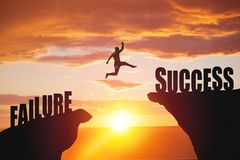Silhouette of business man jump to success text stock photo