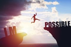 Silhouette of business man jump to success text over a beautiful view mountain background stock images