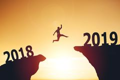 Silhouette of business man jumping from 2017 to 2018 royalty free stock photo