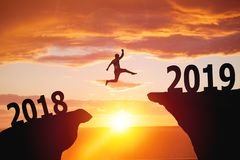 Silhouette of business man jumping from 2018 to 2019. Silhouette of man jumping from 2018 to 2019 text stock photos