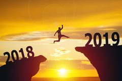 Silhouette of business man jumping from 2018 to 2019 royalty free stock photos