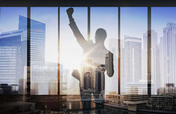 Silhouette of business man over city background Stock Photo