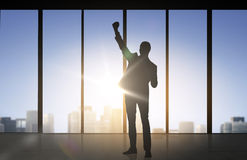 Silhouette of business man over office background Stock Image