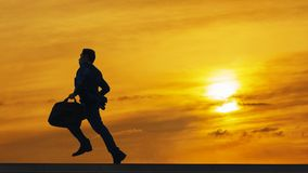Silhouette business man run with laptop briefcase at pedestrian royalty free stock photos