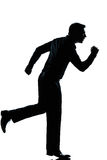 Silhouette business man running full length. One caucasian business man running full length silhouette in studio isolated white background royalty free stock image