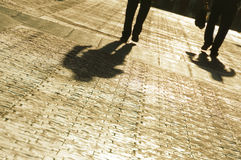 Silhouette of business men. Walking with long shadows Royalty Free Stock Image