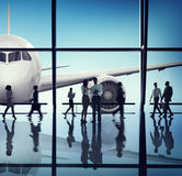Silhouette of Business People with Airplane Concepts Stock Images