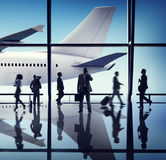 Silhouette of Business People with Airplane Concepts Royalty Free Stock Photography