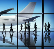 Silhouette of Business People with Airplane Concepts Stock Photos