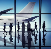 Silhouette of Business People with Airplane Concepts Stock Photo