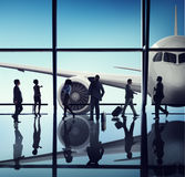 Silhouette of Business People with Airplane Concepts Stock Photography