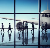 Silhouette of Business People with Airplane Concepts Royalty Free Stock Photo