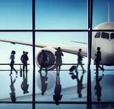 Silhouette of Business People with Airplane Concepts Royalty Free Stock Images