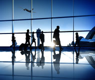Silhouette of Business People in the Airport Stock Photo