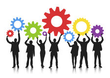Silhouette of Business People Holding Gears Royalty Free Stock Photo