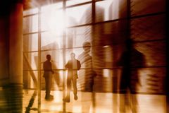 Silhouette of Business People Posing by Window. Silhouette of businessmen on windows.  Stock Photo