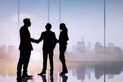 Silhouette business people shake hand and negotiation in office, successful discussion concept royalty free stock image