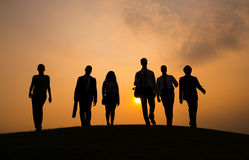 Silhouette of Business People Walking Stock Photo