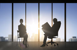 Silhouette of business people working at office Stock Images