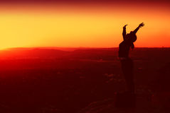 Silhouette of Business Woman. Silhouette of African American Business Woman on top of Hill during Sunset Stock Photos