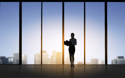 Silhouette of business woman with folders stock illustration