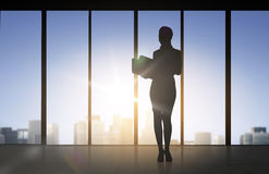 Silhouette of business woman with folders Stock Photos