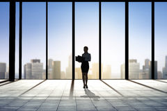 Silhouette of business woman with folders Stock Images