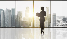 Silhouette of business woman with folders Stock Photo