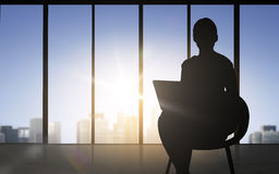 Silhouette of business woman with laptop Stock Photography
