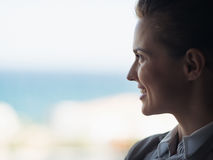 Silhouette of business woman looking into window Royalty Free Stock Photos