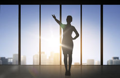 Silhouette of business woman pointing hand Royalty Free Stock Image