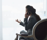 Silhouette of business woman talking cell phone. Rear view Stock Photos