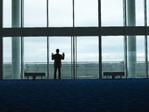 Silhouette Businessman At The Airport Lobby Window Royalty Free Stock Photography