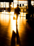 Silhouette businessman in airport preparing for departure Royalty Free Stock Photo