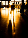 Silhouette businessman in airport preparing for departure Royalty Free Stock Image