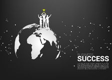 Silhouette of businessman and businesswoman with champion trophy standing on world map. vector illustration