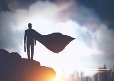 Superman businessman silhouette in city stock photos
