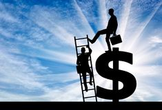 Concept of inequality and injustice. Silhouette of a businessman climbs the stairs, and another businessman standing on a dollar symbol pushes this ladder. The stock images