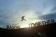 Silhouette of businessman glowing jump alone to together. succes Stock Photography