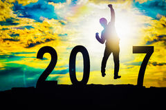 Silhouette businessman jumping over 2017 Stock Photo