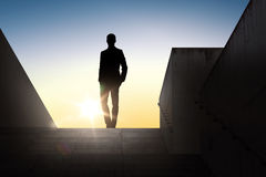 Silhouette of businessman over sun light Royalty Free Stock Image
